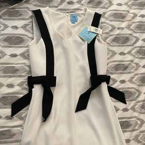 Cute formal White dress with black bows